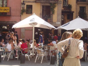 Rather than just OBSERVING the scene -- such as this oneoutside the hip La Vinya del Senyor wine bar near Barcelona's famed Basílica de Santa Maria del Mar -- why not meet the locals hanging out here? Even simple conversations with a place's residents can make your overseas trip much richer.